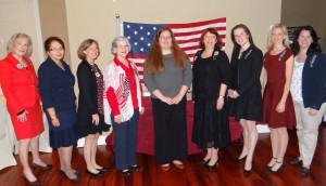 Newly installed chapter officers stand in front of the 15-star flag.