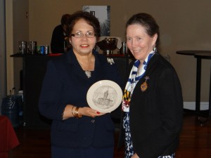 Chapter Historian Dr. Marion T. Lane presents a gift to President National Jacque-Lynne Schulman.